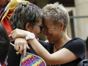 LGBT rights activists Sandra Rojas, left, and Adriana Gonzalez celebrate a Constitutional Court decision to give gay couples marriage rights, in front of the Justice Palace in Bogota, Colombia, Thursday, April 7, 2016. Gay couples in Colombia are already allowed to form civil unions, but the court ruling by a 6-3 vote expands rights further by giving gay couples marriage rights as well.  (AP Photo/Fernando Vergara)